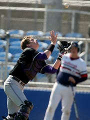 North Kitsap's Kyle Green tries to make a foul-tip catch against Lindbergh during a game at the Kitsap County Fairgrounds on Saturday, May 5, 2018.