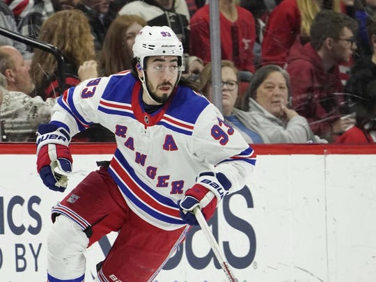 Feb 21, 2020; Raleigh, North Carolina, USA;  New York Rangers center Mika Zibanejad (93) skates with the puck against the Carolina Hurricanes at PNC Arena. The New York Rangers defeated the Carolina Hurricanes 5-2. Mandatory Credit: James Guillory-USA TODAY Sports