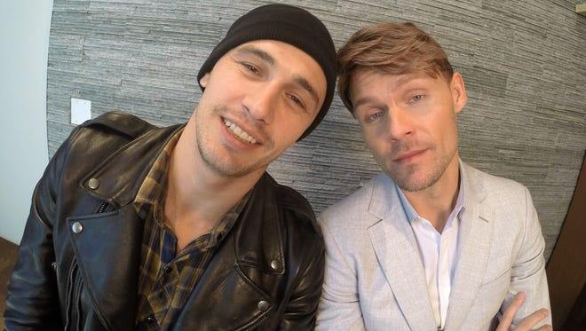 """James Franco, left, and Scott Haze pose in Toronto, during the Toronto International Film Festival on Sept. 7, 2014. Franco and Haze star in the film, """"The Sound and the Fury."""""""