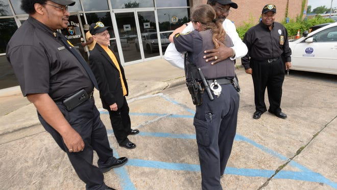 The Rev. Danny Thompson gets a hug from Corp. Kim Broome before the group leaves for patrol.