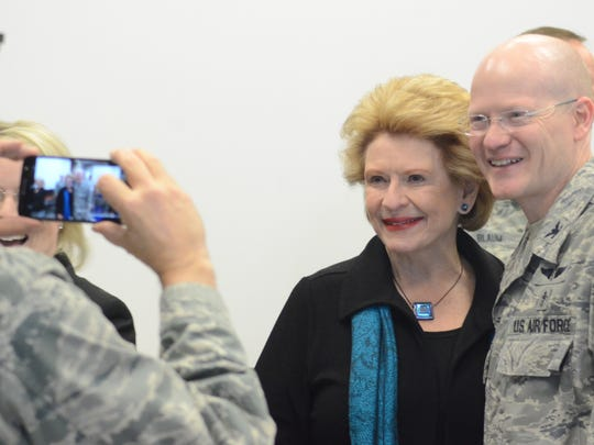U.S. Sen. Debbie Stabenow poses for a photo with Col.