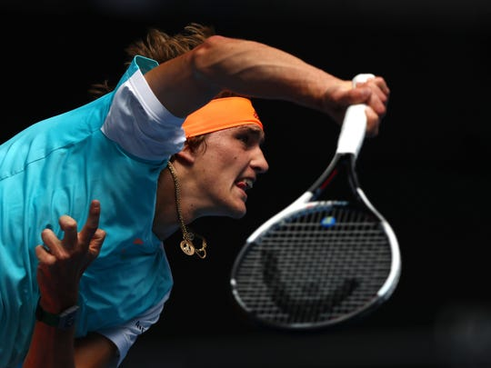Alexander Zverev of Germany serves in his first round match against Robin Haase of the Netherlands on day two of the 2017 Australian Open at Melbourne Park.