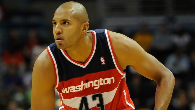 Washington Wizards forward Brian Cook plays against the Milwaukee Bucks