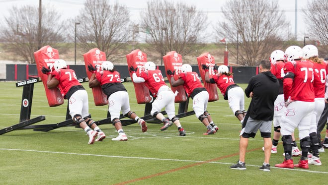 Louisville Cardinals offensive linemen get in some reps during the football open practice session.
