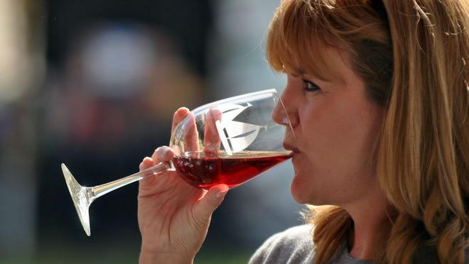 A woman samples wine during a previous Autumn Wine Festival at Pemberton Historical Park in Salisbury.