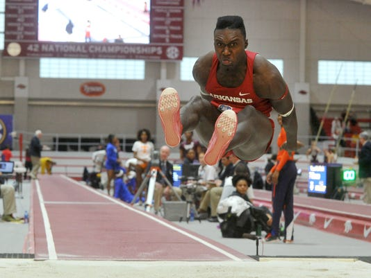 In this Saturday, Feb. 27, 2016 photo, Arkansas' Clive Pullen lands a jump in the men's triple jump at the Southeastern Conference Indoor Track and Field Championships in Fayetteville, Ark. Jamaica might be an Olympic sprinting superpower, but when it comes to the rest of the track and field program the tiny nation is on shaky footing at best. Pullen will represent Jamaica in the triple jump at the Rio Games.  (Michael Woods/The Arkansas Democrat-Gazette via AP)