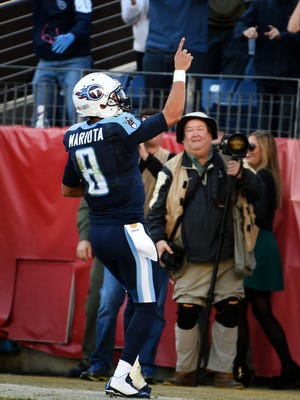 Marcus Mariota (8) celebrates in the end zone after scoring a touchdown in the fourth quarter the Titans played the Jaguars on Sunday, Dec. 6, 2015 at Nissan Stadium.