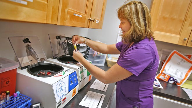 Lori Johnson gets clients' blood ready at Any Lab Test Now in Greenwood.