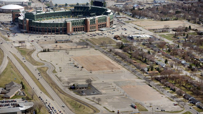 Lambeau Field overlooks the Titletown District in this April aerial view looking east.