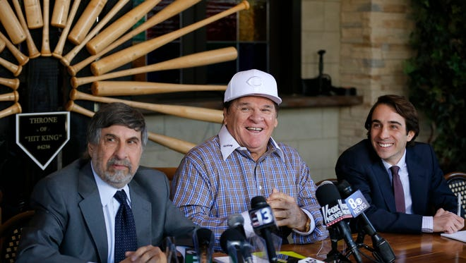 Flanked by his attorneys, Pete Rose laughs as he answers questions during a press conference at the Pete Rose Sports Bar and Grill in Las Vegas on Tuesday.