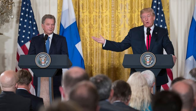President Trump, right, and Finnish President Sauli Niinisto, left, participate in a joint news conference in the East Room of the White House in Washington, D.C., on Aug. 28, 2017.