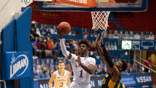 Kansas junior guard Tyon Grant-Foster scores on a layup in the second half of Saturday's game against North Dakota State at Allen Fieldhouse in Lawrence. The Jayhawks won 65-61.