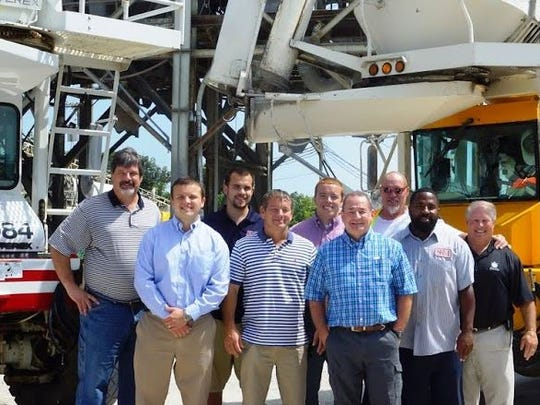 Members of the Metro and Smyrna Ready Mix teams, from left, Mike Zagula, Jeff Hollingshead, Zach Gallagher, Mike Hollingshead, Ryan Hollingshead, Bobby Phillips, Wally Harris, Dirk Todd and Tom Zoeller, gather to commemorate the joining of the two companies.