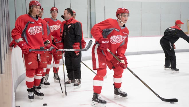 Dylan Larkin and teammates wait for the start of drills Saturday in Traverse City.