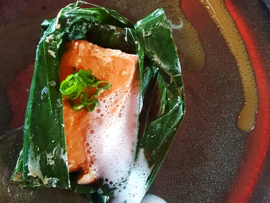 Ora King salmon steamed in a banana leaf with lemongrass