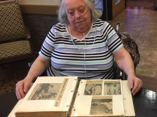 Barbara McInteer of Chandler, Arizona, often looks at the scrapbook of clippings detailing the murder of her policeman father, Harold Pearce, in 1956.