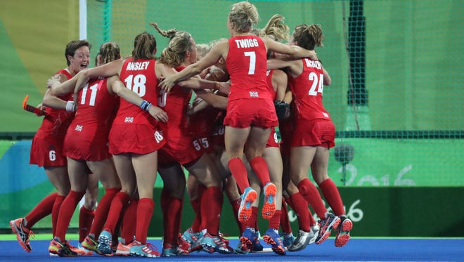 Great Britain defender Hollie Webb (20) celebrates with teammates after scoring the game winning goal in a shoot out past Netherlands goalkeeper Joyce Sombroek during the gold medal match in the Rio 2016 Summer Olympic Games at Olympic Hockey Centre.