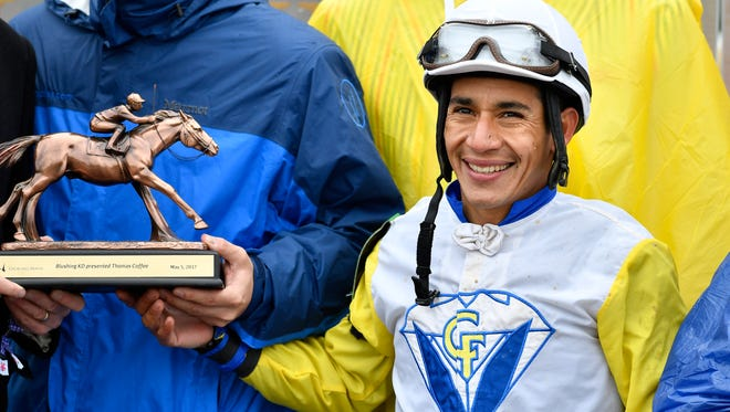 Paco Lopez is all smiles after winning a race in this 2017 file photo. Lopez was in the zone on Saturday, winning three separate races at Del Mar atop three different horses.