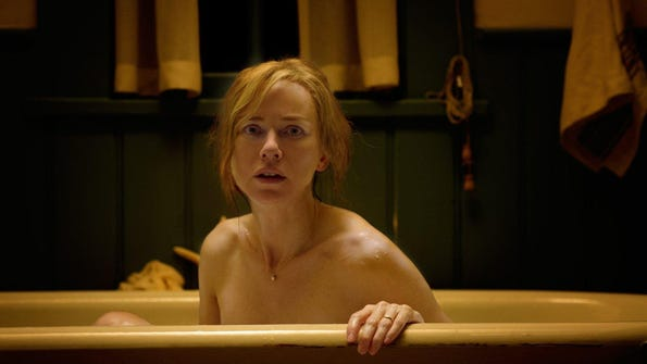 "Naomi Watts falls asleep in a bathtub in ""Shut In."""