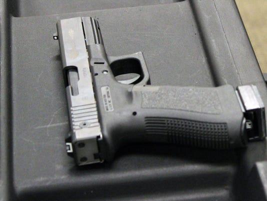 636530097715180811-handgun.jpg