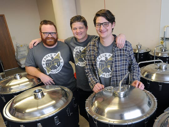Jake Schinker (from left) and brothers Max and Jackson Borgardt, all owners of Eagle Park Brewery, gather inside their East Hamilton Street brewery in Milwaukee in 2018. The partners are in the process of opening an additional brewery and restaurant in Muskego to meet their production demands.