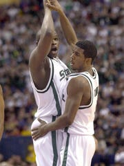 MSU's Zach Randolph and Marcus Taylor celebrate after