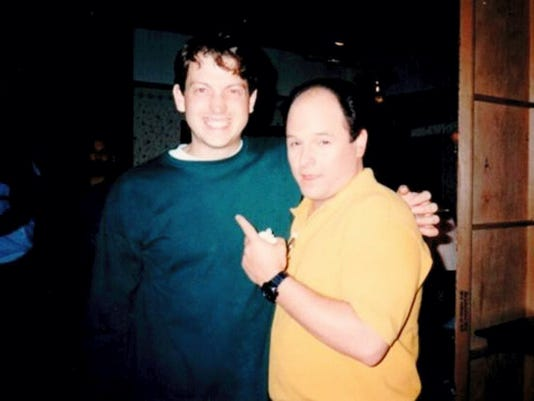 """Local TV sitcom writer Darin Henry poses with Jason Alexander, known for his role as George Costanza on """"Seinfeld."""" Henry worked on the show as a production assistant and freelance writer for five years."""