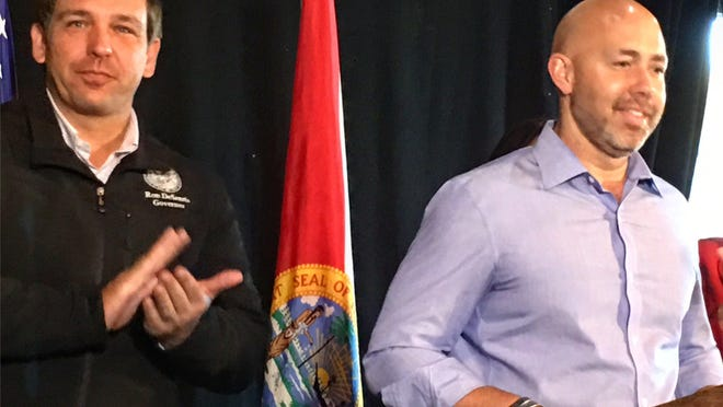 Gov. Ron DeSantis and U.S. Rep. Brian Mast, R-Palm City, at a press conference Jan. 10, 2019 in Stuart where DeSantis asked for the South Florida Water Management District governing board to resign.