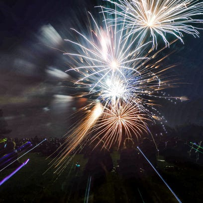 People watch the fireworks at City Park, Saturday,