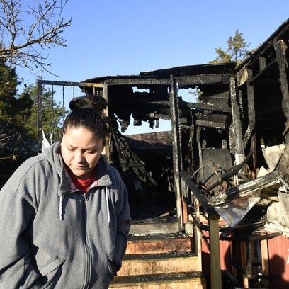 Lizabeth Martinez, 20, outside her neighbors' mobile