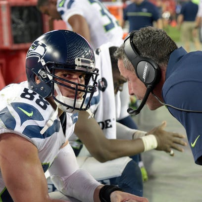 Seattle Seahawks tight ends coach Pat McPherson, right,