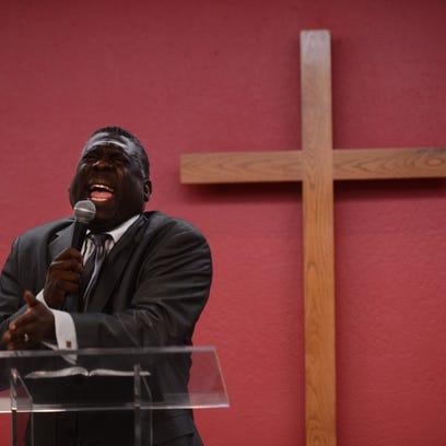 Bishop Broderick A. Huggins conducts a service last