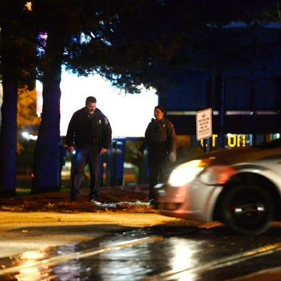 Salisbury Police officers examine the scene of crash
