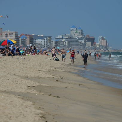 Umbrella's and crowds are starting to cover the beach
