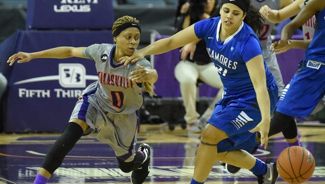 Camary Williams of the University of Evansville pokes the ball away from Brooklyn Artis of Indiana State during the second quarter of the game at the Ford Center in Evansville Friday.