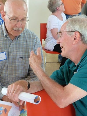 Affiliate members Charles Hesse of Coralville, left, and Dwight Tardy of Iowa City talk shop during a TRAIL social event last summer at the Eastside Recycling Center in Iowa City.