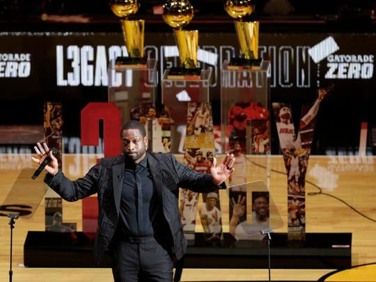 Former Miami Heat guard Dwyane Wade reacts during a ceremony for his jersey retirement at halftime as the Heat host the Cleveland Cavaliers in an NBA basketball game Saturday, Feb. 22, 2020, in Miami. (David Santiago/Miami Herald via AP)