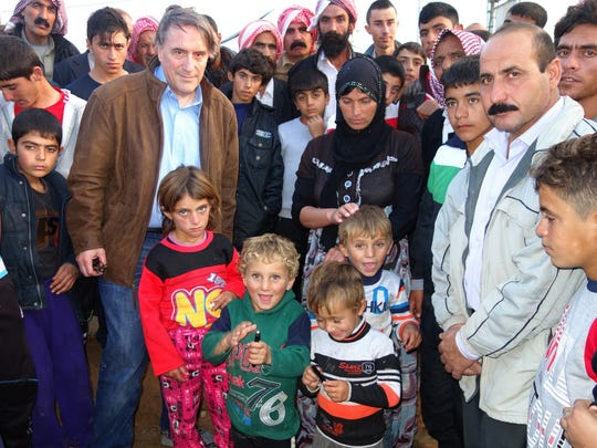 Peter Galbraith, a former Democratic Vermont state senator and former U.S. diplomat, shared this photo with members of the Syrian Yazidi religious minority at a refugee camp in Iraq in December 2014.