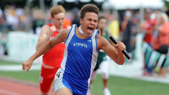 Wynford senior Tony Watson screams his way across the finish line after winning the 4x100 relay state championship on Saturday at Jesse Owens Memorial Stadium in  Columbus
