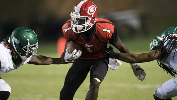 Senior wide receiver Ty Hellams (1) and the Greenville Red Raiders are No. 8 in Class AAAA heading into their game No. 7 Greer Friday at Dooley Field.