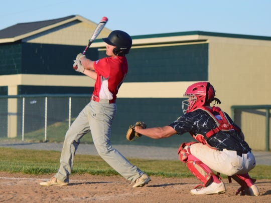 Augusta's Ty Hevener connects for a single during the