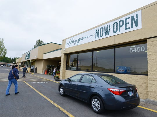 Customers arrive at Haggen grocery store during the opening on Tuesday in Keizer.