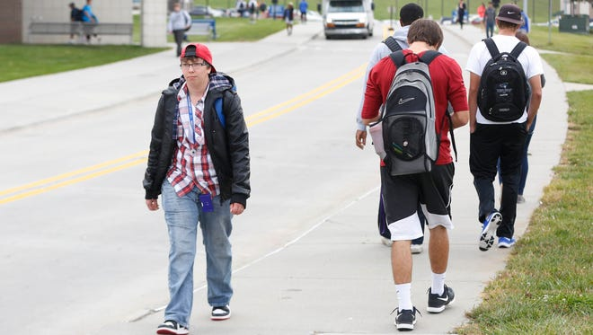 Mikey Fletcher of Omaha, Neb., walks to class Wednesday, Oct. 7, 2015, at Iowa Western Community College in Council Bluffs. Fletcher, a transgender male, is living in gender-neutral housing.