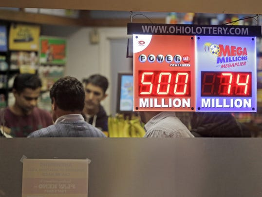 Customers wait to buy lottery tickets at Gateway Newstands in Cleveland Wednesday, Feb. 11, 2015. The Powerball jackpot has climbed to 500 million, making Wednesday night's drawing the fifth largest prize in U.S. history. (AP Photo/Mark Duncan)