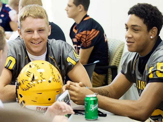 Red Lion quarterback Dalton Grove, left, and receiver Kendrick Boyd-Gillespie have a laugh with a reporter Aug. 3 during the York-Adams Football Media Day at the York Newspaper Company. The Lions have arguably the most lethal quarterback-wide receiver duo returning from 2014 with Grove and Boyd-Gillespie.