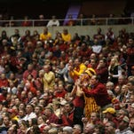 Iowa State fans stand up to cheer during the North Dakota State University at Iowa State men's basketball game on Tuesday, Dec. 1, 2015, in Hilton Coliseum. The Cyclones beat the Bison 84-64.