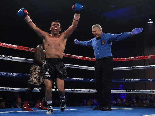 """Reno's Santos Vasquez defeats Anthony Taylor during the Top Rank """"Cinco de Mayo"""" boxing event at the Reno/Sparks Convention Center in Reno on May 5, 2017. Vasquez won the fight by TKO."""