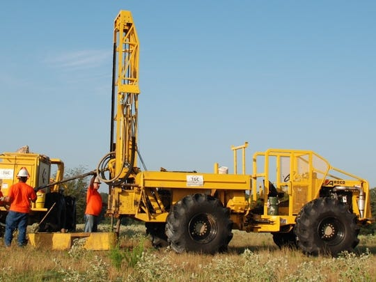 The off-road vehicles are typical of equipment used in upland areas during seismic testing.