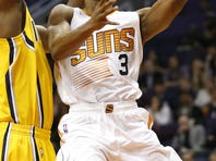 Suns Eric Bledsoe (2) makes a lay-up past Trailblazers Allen Crabbe (23) during Star Wars night at Talking Stick Resort Arena on Dec. 11, 2015 in Phoenix, Ariz.