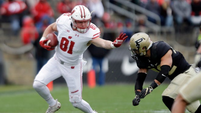 Wisconsin tight end Troy Fumagalli tries to get past Purdue linebacker Andy James Garcia.